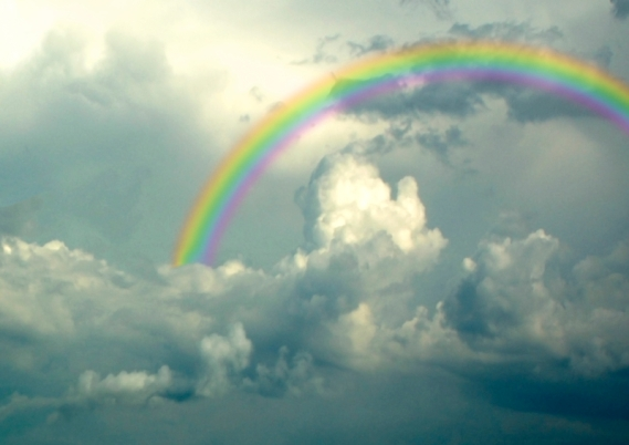 rainbow in grey clouds